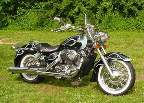 My 1996 Honda Shadow ACE 1100 with custom flames and wide white wall tires